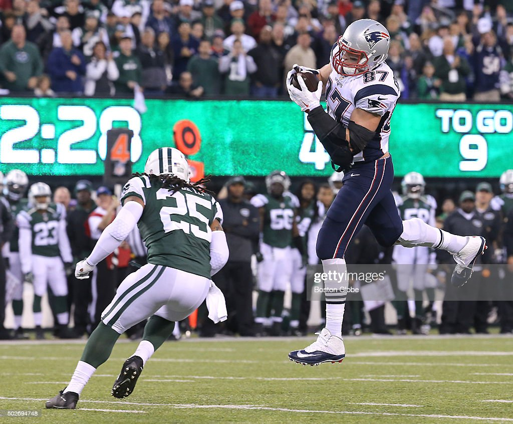 New England Patriots tight end Rob Gronkowski makes a leaping catch, picking up the first down and beating the Jets' Calvin Pryor during fourth quarter action. The New England Patriots played the New York Jets in a regular season NFL game at MetLife Stadium on Sunday, Dec. 27, 2015.