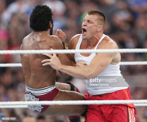 New England Patriots tight end Rob Gronkowski right screams as he hits wrestler Jinder Mahal left in the ring during WrestleMania 33 on Sunday April...