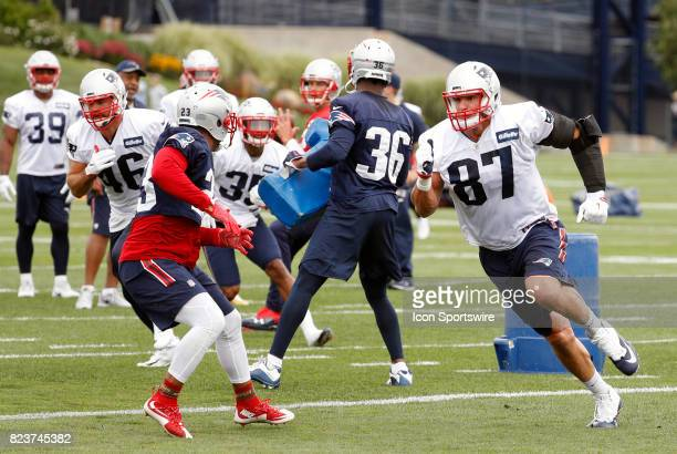New England Patriots tight end Rob Gronkowski runs a route on New England Patriots safety Patrick Chung during New England Patriots training camp on...