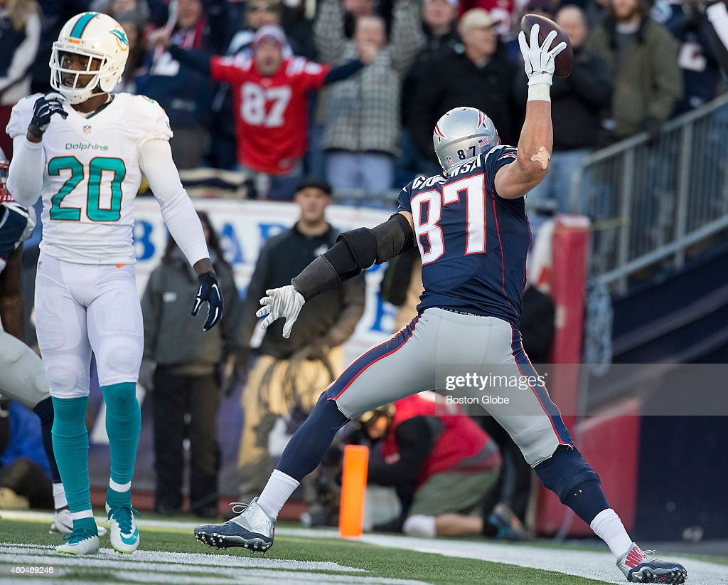 New England Patriots tight end Rob Gronkowski spikes the ball after a 27yard touchdown reception beating the Miami Dolphins' Reshad Jones during...