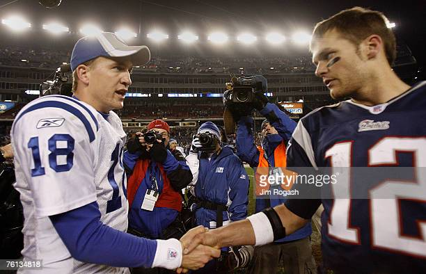New England Patriots' Tom Brady right shakes hands with Indianapolis Colts' Peyton Manning after a game between New England Patriots and Indianapolis...