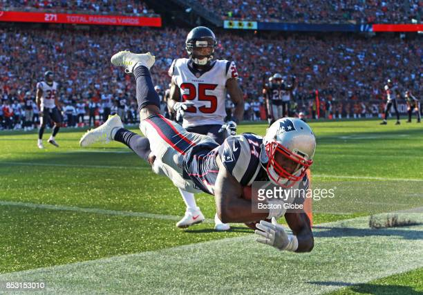 New England Patriots wide receiver Brandin Cooks sails across the goal line as he stayed in bounds to make the gamewinning touchdown late in the...