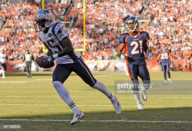 New England Patriots' wide receiver Chad Ochocinco scores the New England Patriots' first touchdown of the game against the Denver Broncos Sunday...