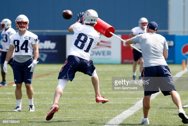 New England Patriots wide receiver Cody Hollister goes for the ball distracted by an assistant coach during New England Patriots OTA on June 13 at...