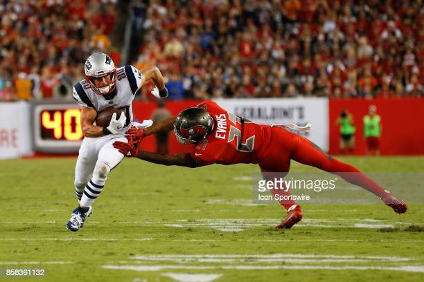 New England Patriots wide receiver Danny Amendola breaks a tackle from Tampa Bay Buccaneers safety Justin Evans during the NFL game between the New...