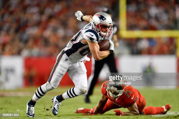 New England Patriots wide receiver Danny Amendola breaks the tackle attempt by Tampa Bay Buccaneers safety Justin Evans during an NFL football game...