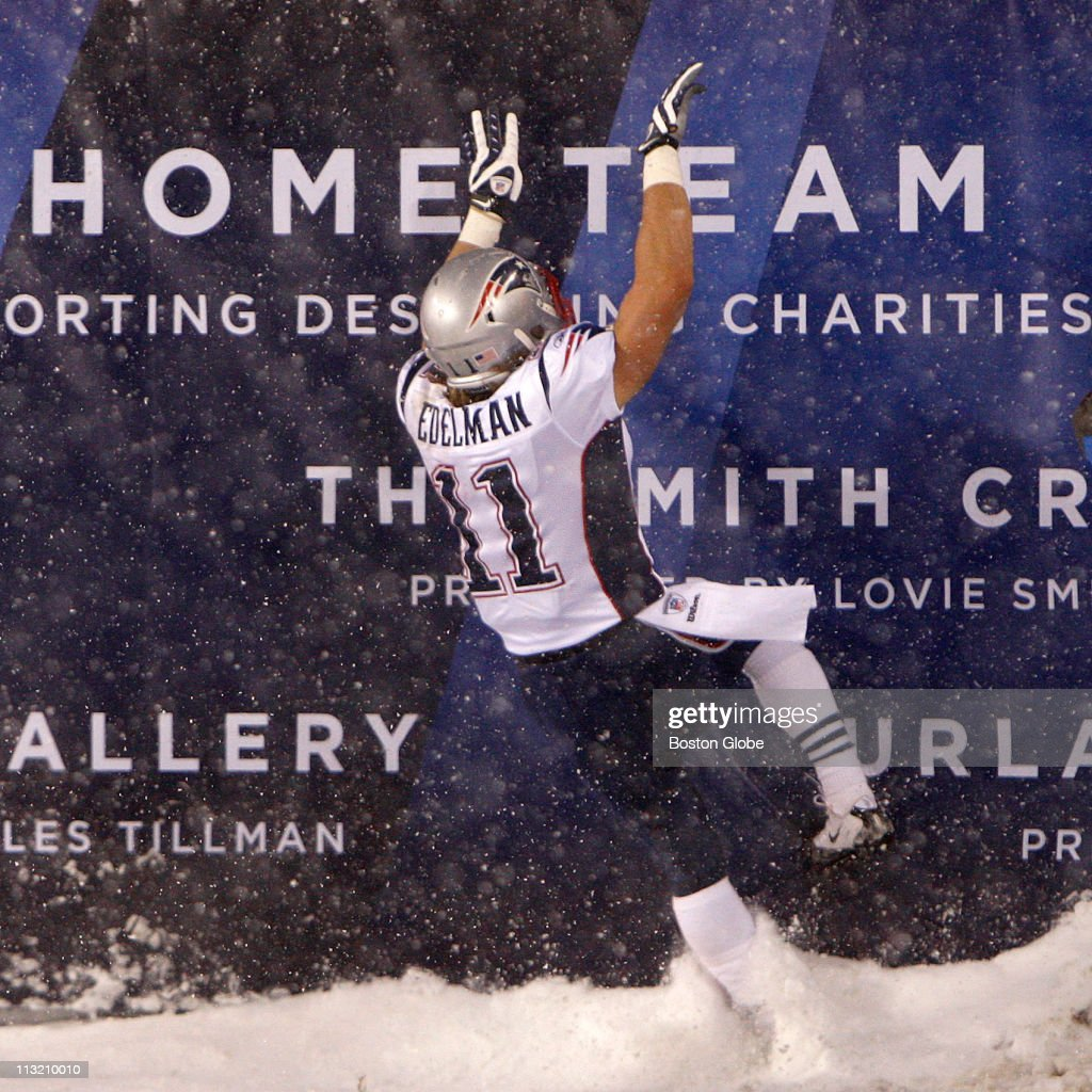 New England Patriots wide receiver Julian Edelman (#11) celebrates in the end zone after he ran back this kick return during the first half for a touchdown, but it was called back because of a Patriot penalty.