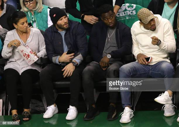 New England Patriots wide receiver Julian Edelman second from left sits courtside during the game The Boston Celtics host the Washington Wizards in...