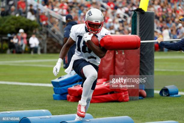New England Patriots wide receiver Matthew Slater avoids a jab during New England Patriots training camp on July 27 at the Patriots Practice Facility...