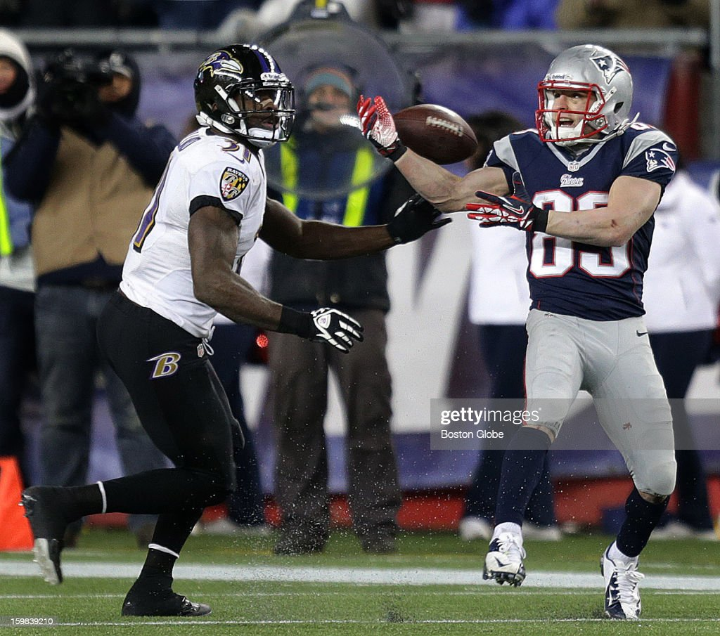 New England Patriots wide receiver Wes Welker (#83) can't hold on to the pass with the ball on the 19 yard line and the Patriots trailing 13-28 in the fourth quarter and 8:39 left on the clock as the New England Patriots hosted the Baltimore Ravens in the AFC Championship Game at Gillette Stadium.