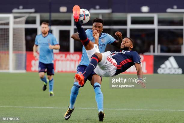 New England Revolution defender Andrew Farrell bicycle kicks the ball away from New York City FC forward Rodney Wallace during a match between the...