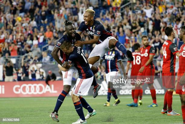 New England Revolution defender Antonio Mlinar Delamea and New England Revolution forward Juan Agudelo reacts to the goal from New England Revolution...