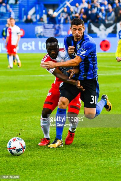 New England Revolution defender Beajamin Angoua and Montreal Impact midfielder Blerim Dzemaili collide together while chasing the ball during the New...