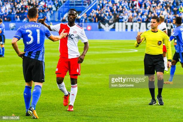 New England Revolution defender Beajamin Angoua shakes hand with Montreal Impact midfielder Blerim Dzemaili in front of the referee after a bad...