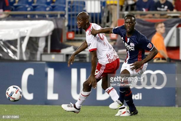 New England Revolution defender Benjamin Angoua keeps close tabs on New York Red Bulls forward Bradley WrightPhillips during a regular season MLS...