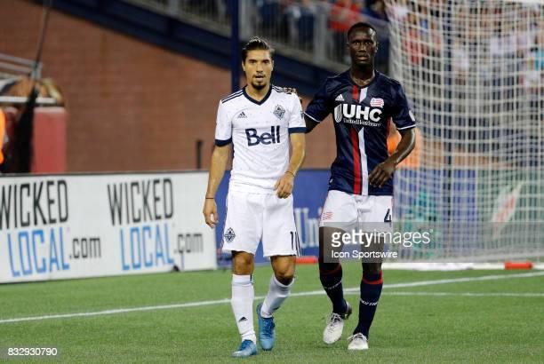New England Revolution defender Benjamin Angoua keeps close tabs on Vancouver Whitecaps midfielder Nicolas Mezquida during an MLS match between the...