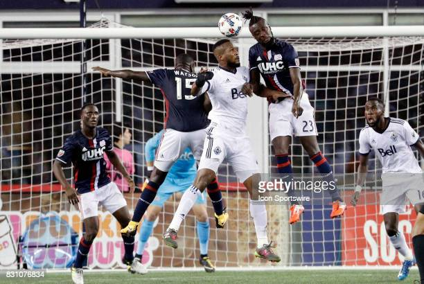 New England Revolution defender JeVaughn Watson and New England Revolution forward Kei Kamara battle with Vancouver Whitecaps FC defender Kendall...