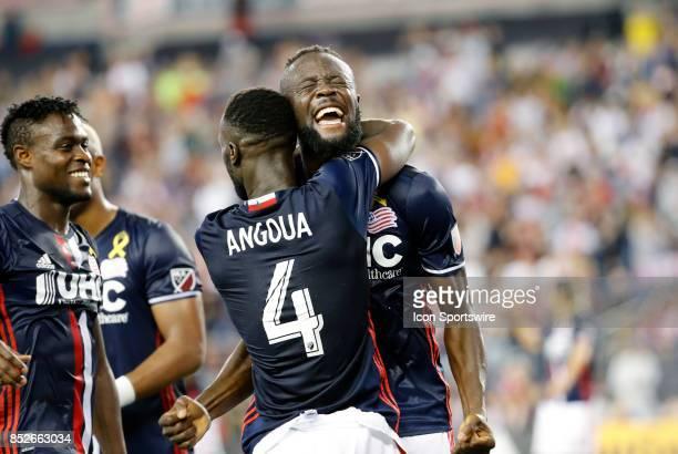 New England Revolution forward Kei Kamara celebrates his goal as New England Revolution defender Benjamin Angoua hugs him during a match between the...
