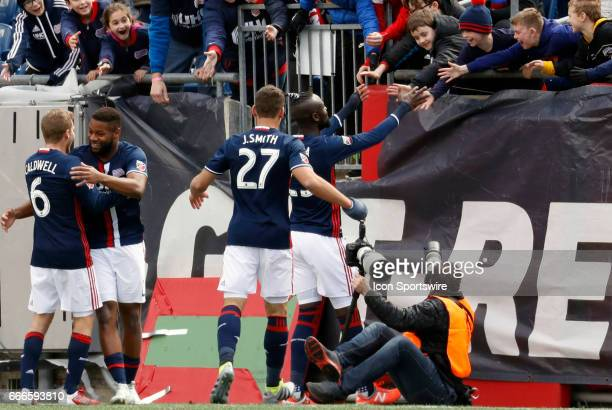 New England Revolution forward Kei Kamara celebrates his goal with young kids in the front row during a regular season MLS match between the New...