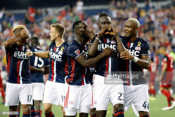 New England Revolution forward Kei Kamara flashes the heart sign after giving the Revolution the lead late during a match between the New England...
