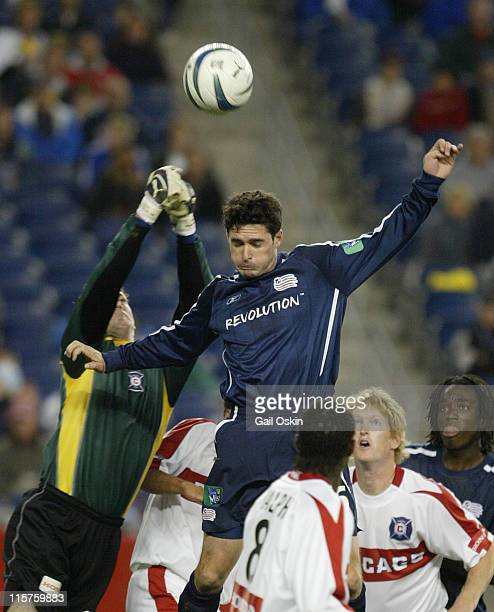 New England Revolution Jay Heaps tries to get the ball past Chicago Fire goalkeeper Henry Ring left at Gillette Stadium in Foxborough Massachusetts...