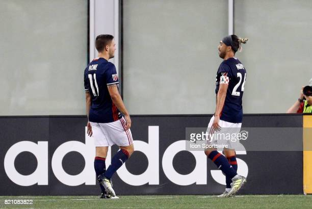 New England Revolution midfielder Kelyn Rowe congratulates New England Revolution midfielder Lee Nguyen on his goal during a regular season MLS match...