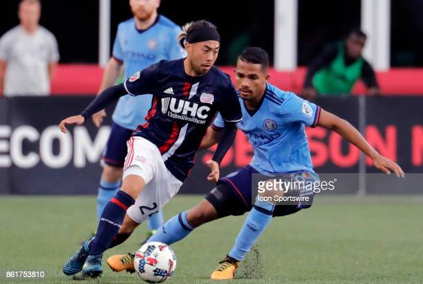 New England Revolution midfielder Lee Nguyen cuts away from New York City FC midfielder Yangel Herrera during a match between the New England...
