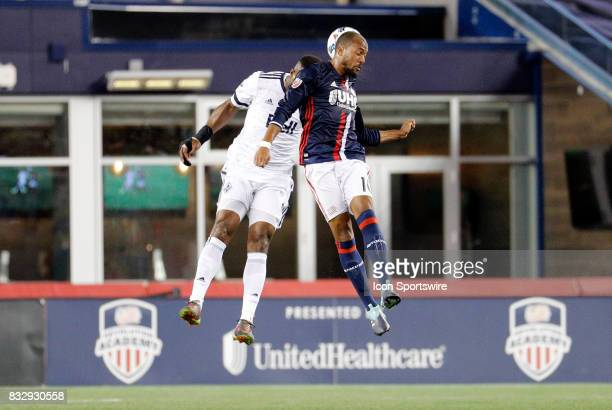 New England Revolution midfielder Teal Bunbury bests Vancouver Whitecaps FC defender Kendall Waston in the air during an MLS match between the New...