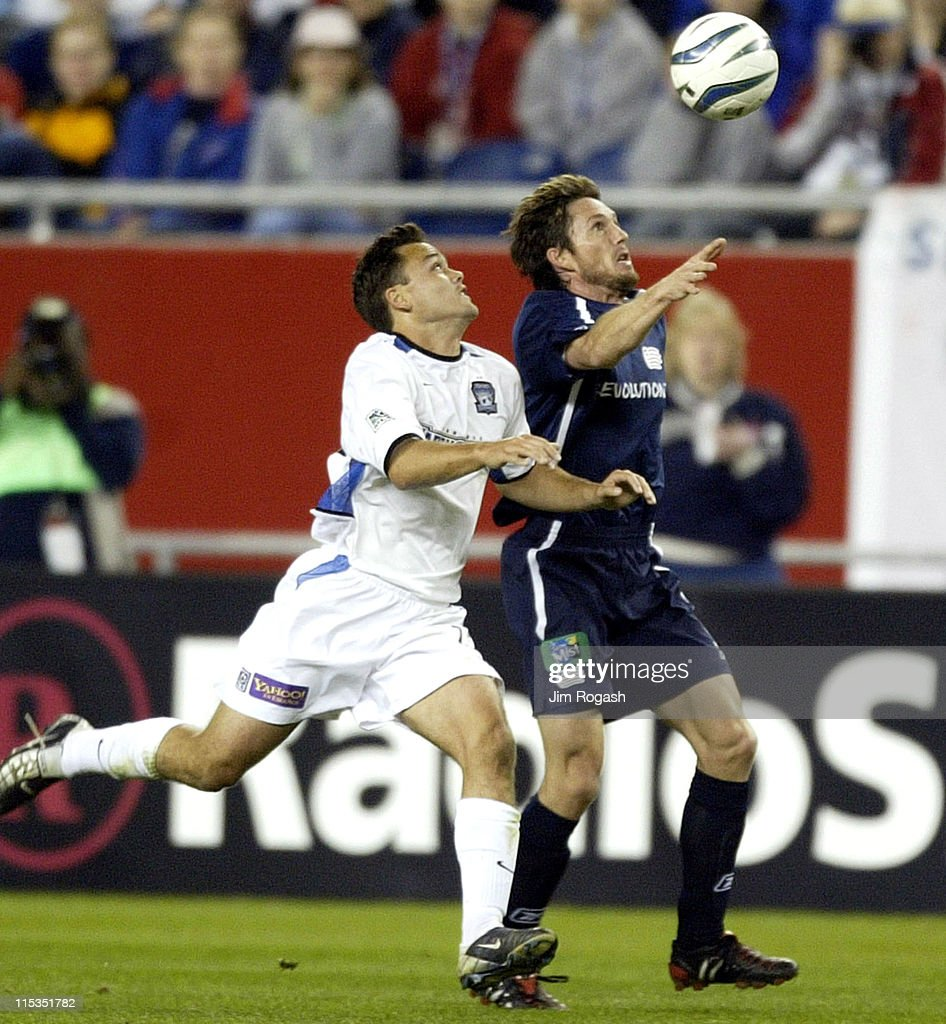 New England Revolution's JoeMax Moore races San Jose Earthquakes' Richard Mulrooney for a loose ball in the first half