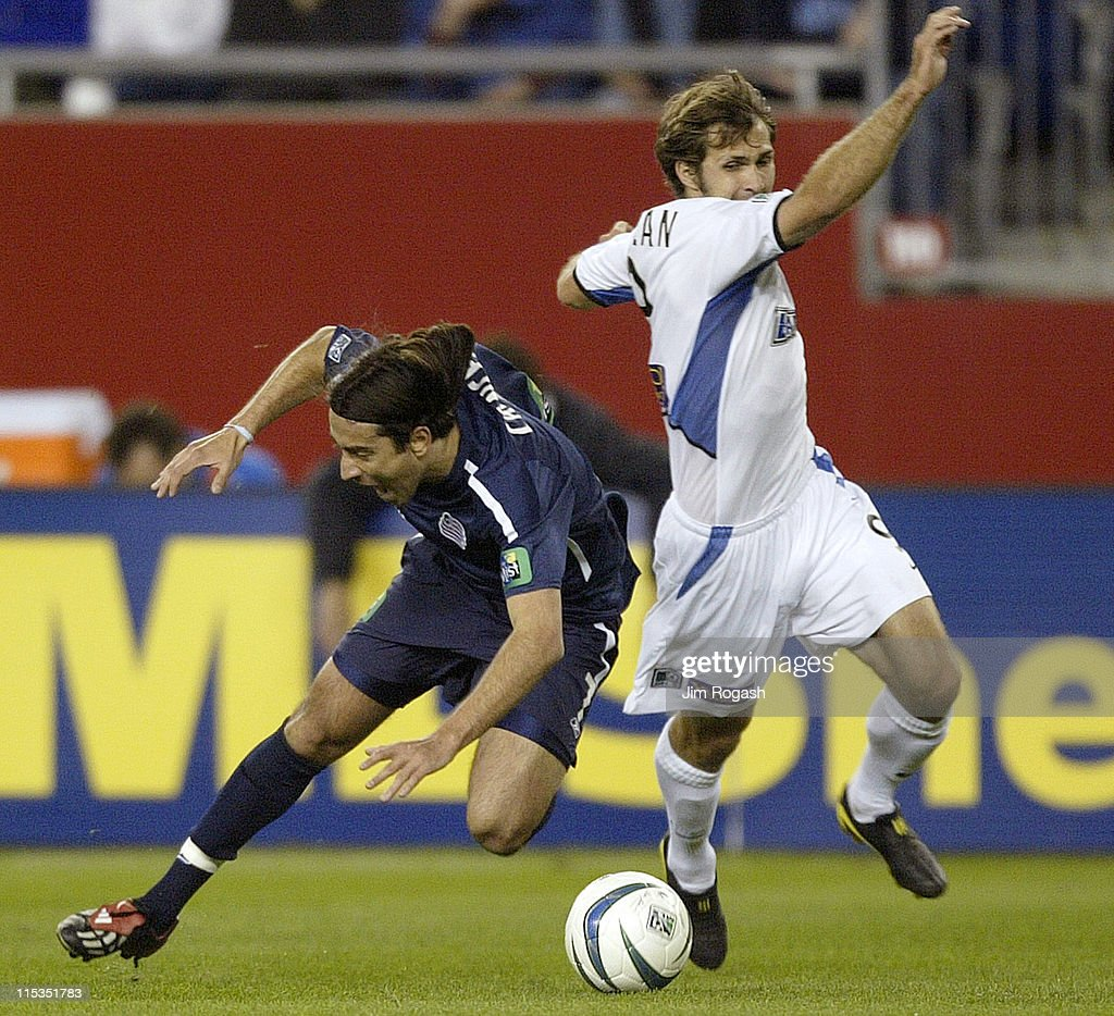 New England Revolution's Jose Carlos Cancela Duran collides with San Jose Earthquakes' Brian Mullen in the first half