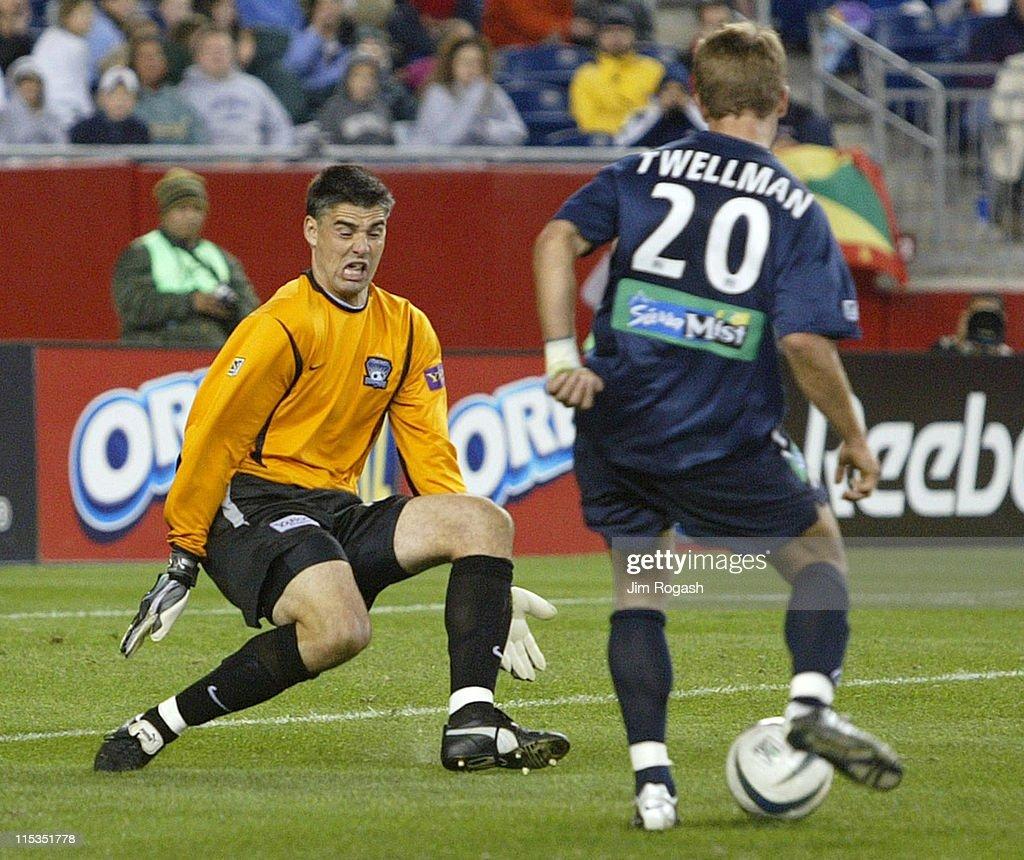 New England Revolution's Taylor Twellman shoots on San Jose Earthquakes' goalie Pat Onstad in the second half