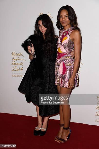 New Establishment winner Simone Rocha and Naomie Harris pose in the winners room at the British Fashion Awards at London Coliseum on December 1 2014...