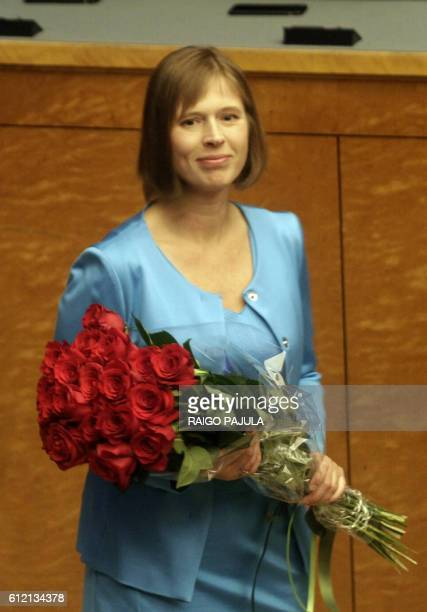 New Estonian President Kersti Kaljulaid holds a bouquet of flowers at Riigikogu the Estonian parliament on October 3 2016 in Tallinn Estonia's...