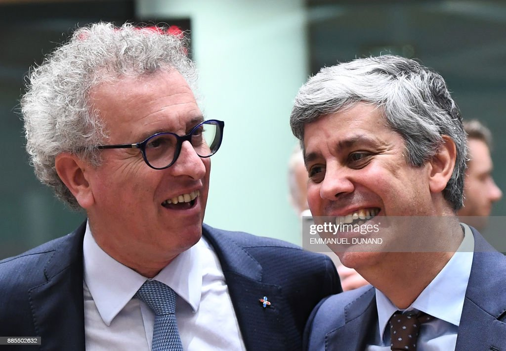 New Eurogroup President Portuguese Finance Minister Mario Centeno (R) speaks with fellow candidate Luxembourg's Finance Minister Pierre Gramegna after winning the votes to become the new Eurogroup chief at the European Council in Brussels on December 4, 2017. /