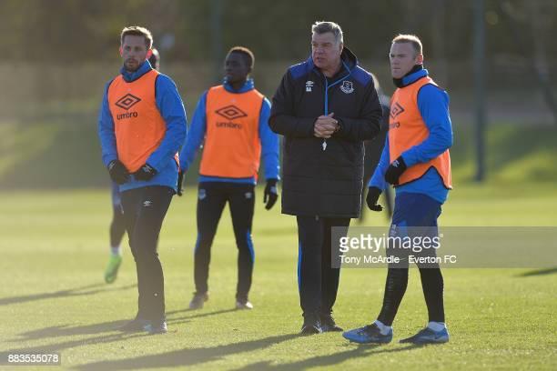 New Everton manager Sam Allardyce with Wayne Rooney Idrissa Gueye and Gylfi Sigurdsson during the Everton training session at USM Finch Farm on...
