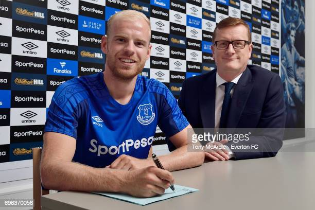 New Everton signing Davy Klaassen poses for a photo with club secretary David Harrison at USM Finch Farm on June 15 2017 in Halewood England