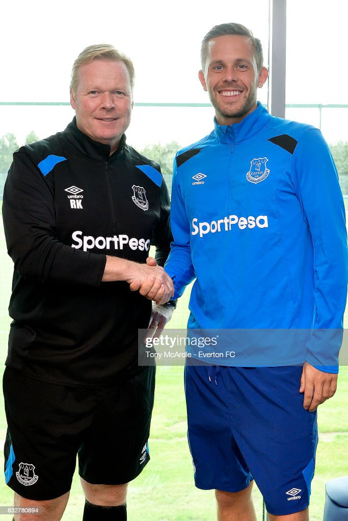 New Everton signing Gylfi Sigurdsson poses for a photo with Everton Coach Ronald Koeman at USM Finch Farm on August 16, 2017 in Halewood, England.