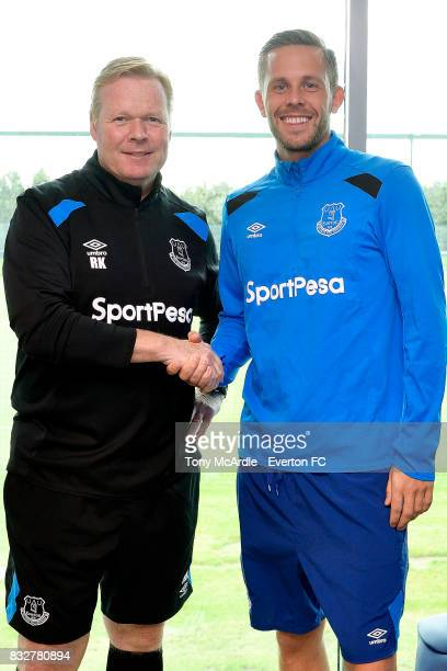 New Everton signing Gylfi Sigurdsson poses for a photo with Everton Coach Ronald Koeman at USM Finch Farm on August 16 2017 in Halewood England