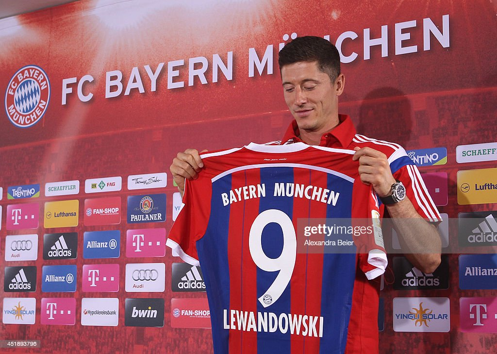 New FC Bayern Muenchen player <a gi-track='captionPersonalityLinkClicked' href=/galleries/search?phrase=Robert+Lewandowski&family=editorial&specificpeople=5532633 ng-click='$event.stopPropagation()'>Robert Lewandowski</a> looks at his new jersey during his presentation at the Bayern Muenchen training ground on July 9, 2014 in Munich, Germany.