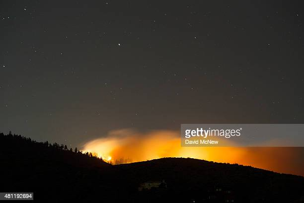 A new fire being dubbed the Pine Fire breaks out in the mountains near the ski community of Wrightwood near the North Fire which caused people to...
