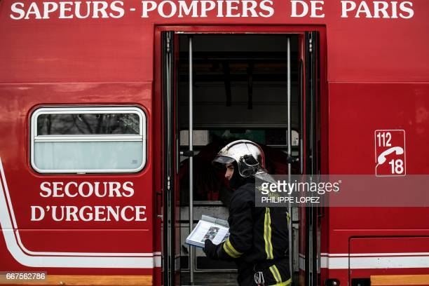 A new firefighter recruit stands in front of a fire truck during an exercise at a training center in VilleneuveSaintGeorges 15 kms southeast of Paris...