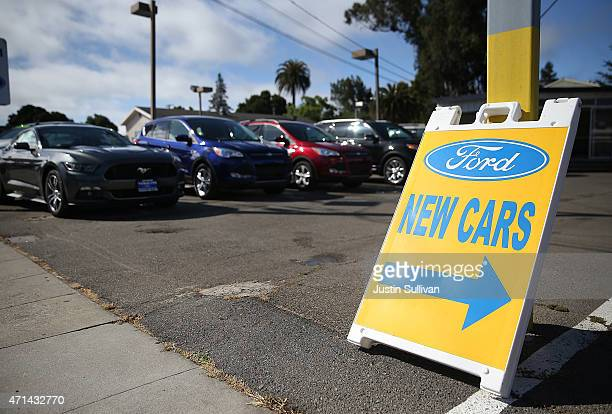 New Ford cars are displayed on the sales lot at Veracom Ford on April 28 2015 in Burlingame California Ford Motor Co reported a 66 percent drop in...