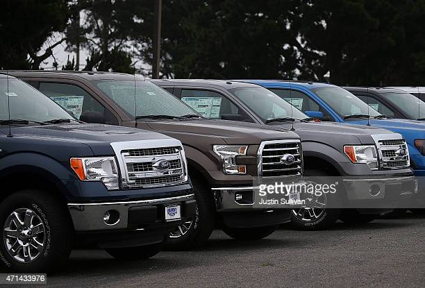 New Ford F150 pickups are displayed on the sales lot at Serramonte Ford on April 28 2015 in Colma California Ford Motor Co reported a 66 percent drop...