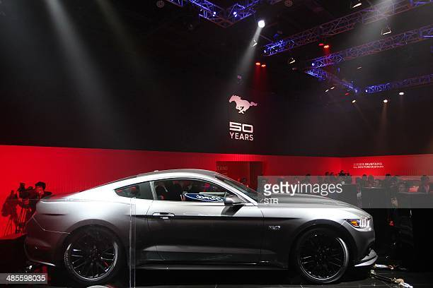 A new Ford Mustang car on display at the 50 years celebration ceremony of the Ford Mustang in Beijing on April 19 ahead of the 'Auto China 2014'...
