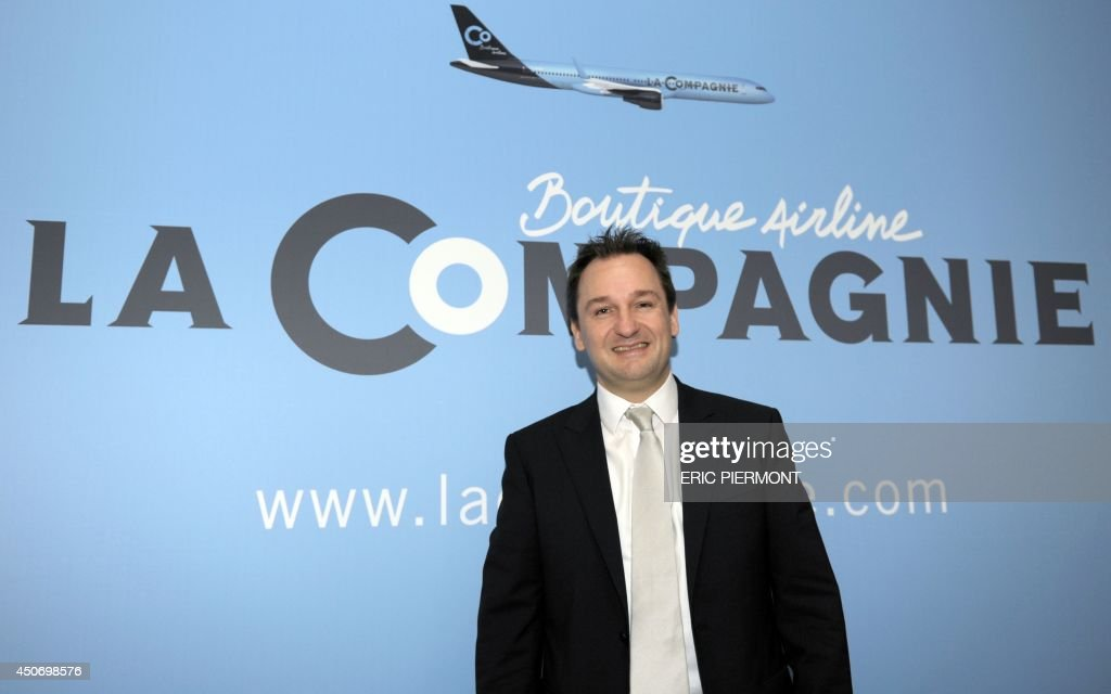 New French airline LaCompagnie Chairman Frantz Yvelin poses during a press conference in Paris on June 16, 2014 to present the new Paris-New York business class airline. AFP PHOTO ERIC PIERMONT
