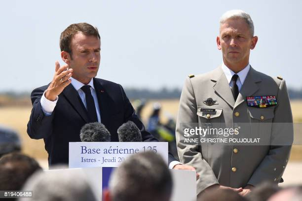 New French chief of military staff General Francois Lecointre listens to French President Emmanuel Macron speaking during his visit to the French air...