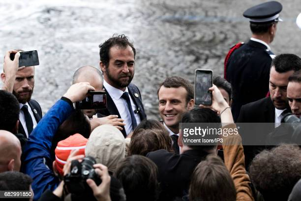 New French President elected Emmanuel Macron speaks with people after attending a tribute ceremony of the Unknown Soldier under the Triumph Arc on...