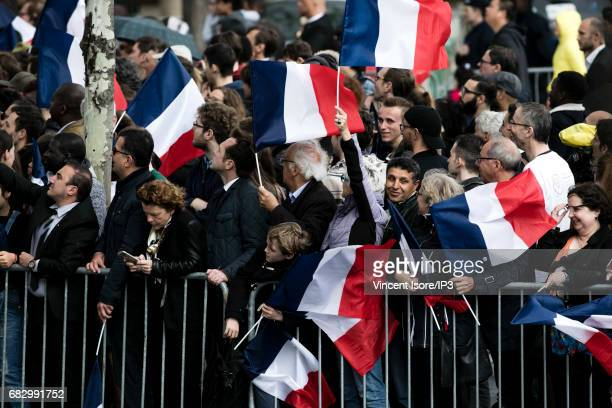 New French President elected Emmanuel Macron travels up the Champs Elysees avenue in order to attend a tribute ceremony of the Unknown Soldier under...