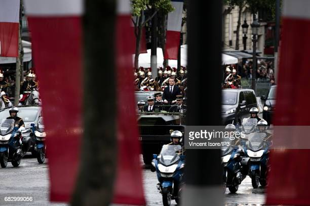 New French President elected Emmanuel Macron travels up the Champs Elysees avenue in a military vehicle in order to attend a tribute ceremony of the...