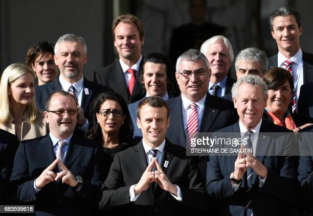 TOPSHOT New French President Emmanuel Macron poses next to the president of the IOC Evaluation Commission for the 2024 Olympics Patrick Baumann and...